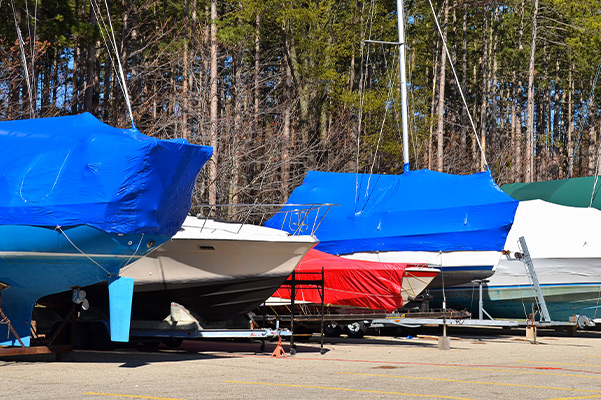 boats lined up with winter covers on them