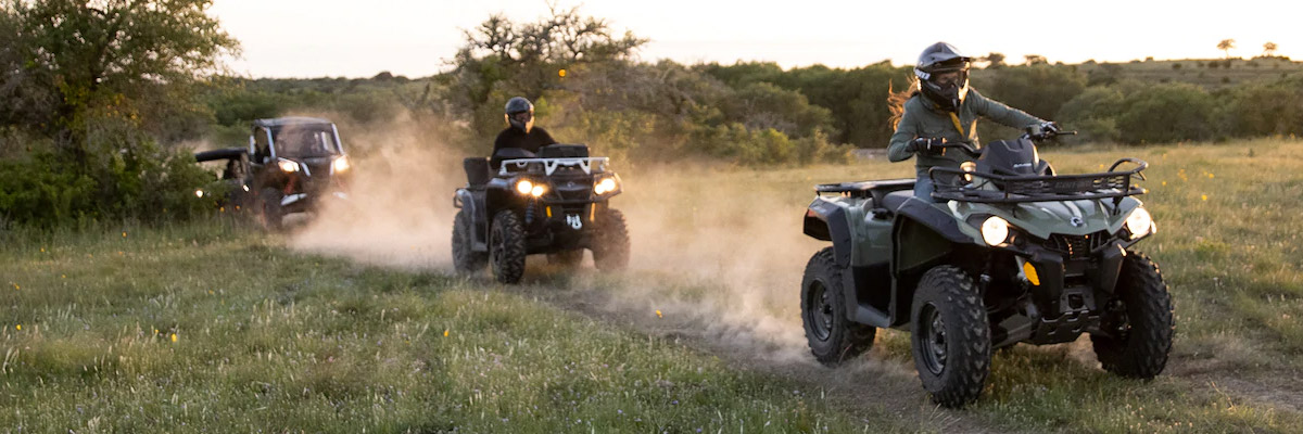 people riding through land with can-am atvs and utvs