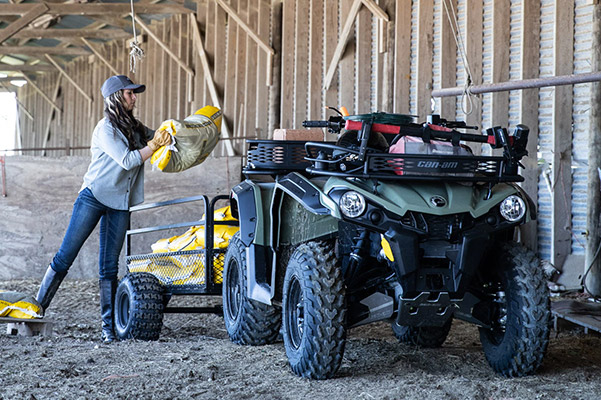 woman loading cement in the back of a 2020 can-am outlander 450 ATV