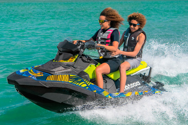 Young kids on colorful Sea-Doo